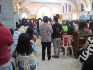 Photo showing people attending an actual Thursday Mass.
